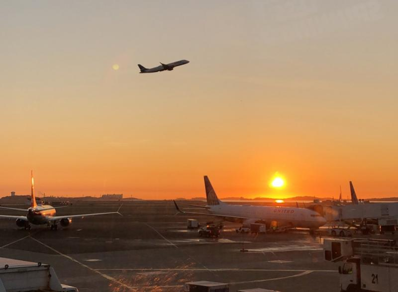 Image of plan taking off during the sunrise.