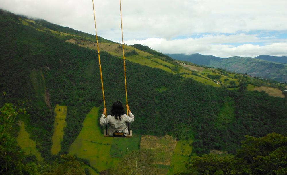 A girl sits on a swing in Ecuador