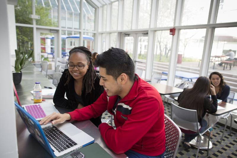 Two students looking at a computer screen
