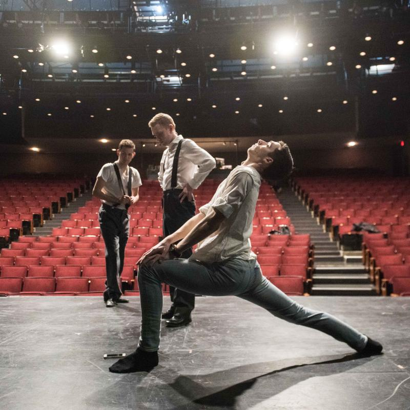 Three students warming up on stage