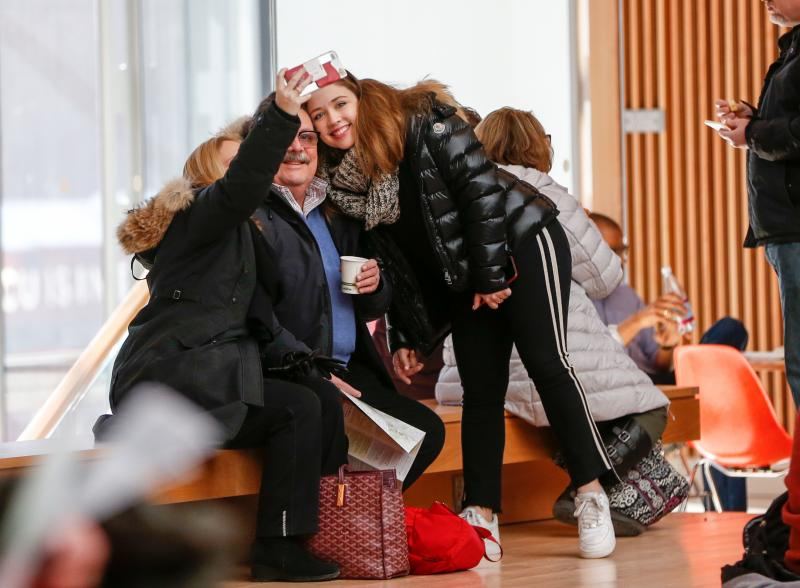 student and family member taking a selfie